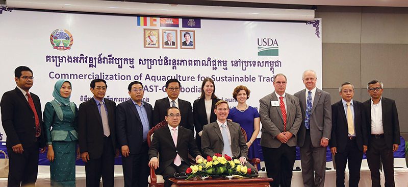 His Excellency Veng Sakhon, Cambodian Minister of Agriculture, Forestry and Fisheries, and Michael E. Newbill, chargé d'affaires at the U.S. Embassy in Cambodia (both seated), announced with other U.S. and Cambodian dignitaries the launch of the Commercialization of Aquaculture for Sustainable Trade project on January 31 in Phnom Penh. Kansas State University's Feed the Future Innovation Lab for Collaborative Research and Sustainable Intensification worked with American Soybean Association's World Initiative for Soy in Human Health to initiate CAST. (photo courtesy of the U.S. Embassy in Phnom Penh)