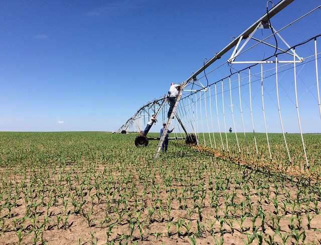 In this file photo, irrigation company crews check the connections of a center pivot system for the ILS farm, which is one of the host sites for the 2019 Technology Field Days series.