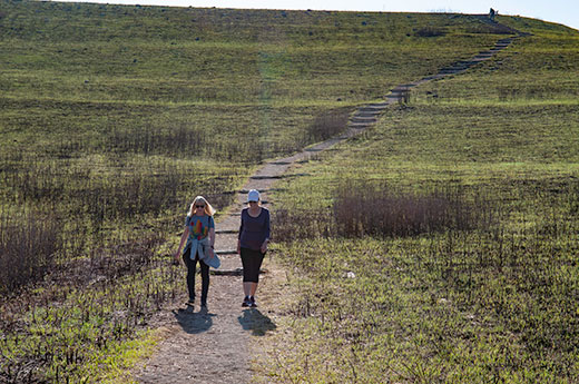 Two women walking along path on Konza Prairie